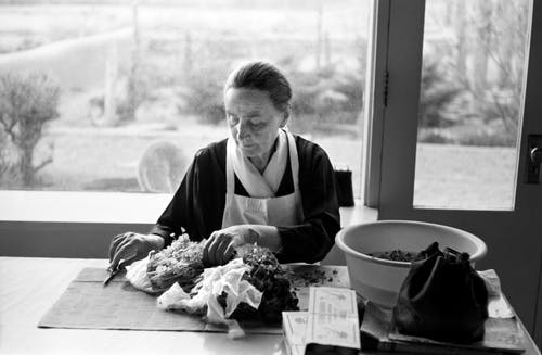 Georgia O'keeffe at her kicthen table.