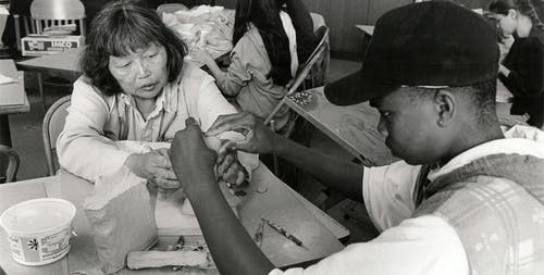 Ruth Asawa works with a student at the public arts high school, 1993.