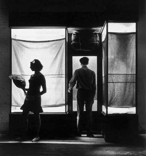 """New York City, 1966 Christo and Jeanne-Claude in Christo's studio with """"Green Store Front, 1964""""."""