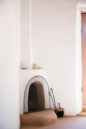 A minimalist fireplace inside the home of Georgia O'keeffe.