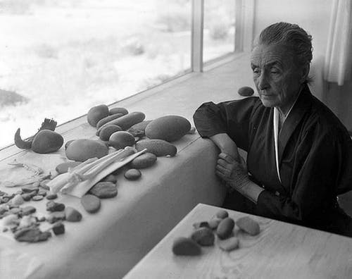 Georgia O'Keeffe with a collection of stones found in the desert.