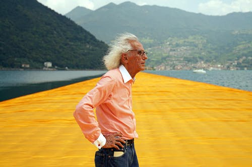 Christo looks out over his completed work: The Floating Piers.