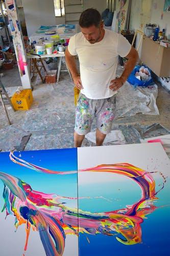 Alex Voinea at work inside his colorful studio.