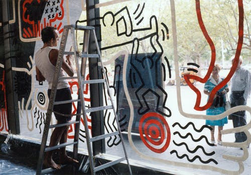 Keith Haring preparing an artwork on the Waterwall at the National Gallery of Victoria.