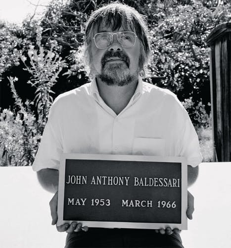 John Baldessari with plaque from Cremation Project, 1970.