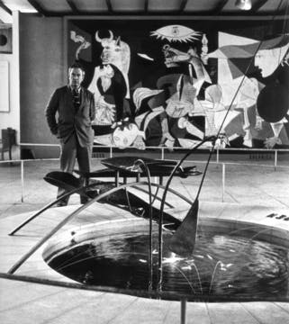 Calder with Mercury Fountain in the Spanish Pavilion at the Paris World's Fair, July 1937.