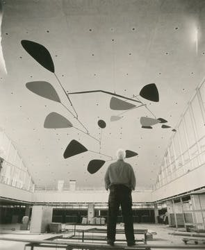 Calder reviewing the installation of .125, Idlewild Airport (now JFK International Airport), New York, 1957, Image via Calder foundation