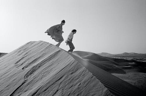 Christo and Jeanne-Claude looking for a possible site for The Mastaba, February 1982.