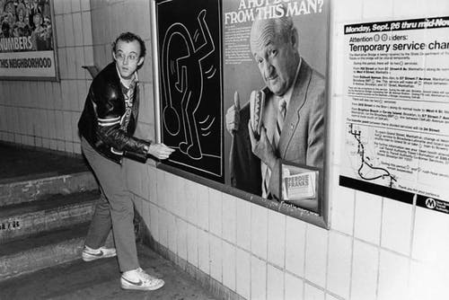 Keith Haring drawing on a subway platform, New York City, c.1982.