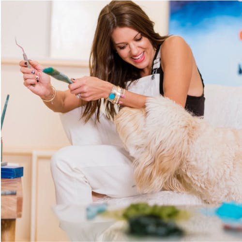 Piper Bridwell in her studio with her dog.