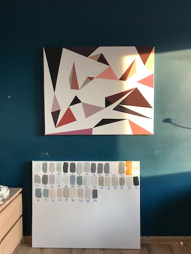 A colour chart and painting in development.