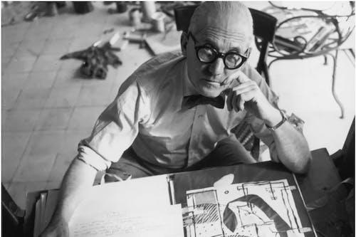 Le Corbusier at his desk.