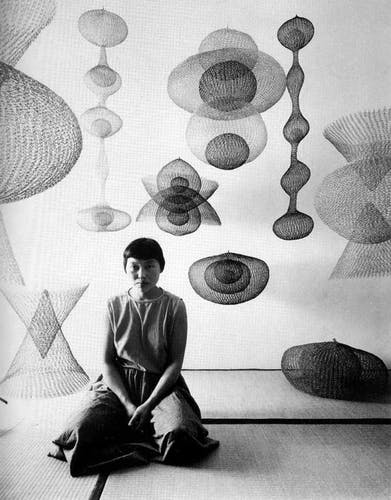 Asawa with a selection of her wire sculptures.