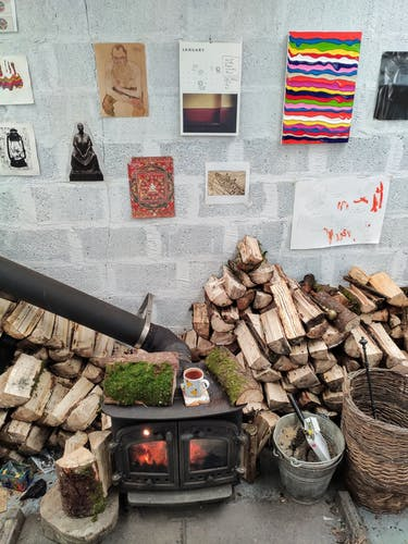 The wood burning stove inside the studio of Derick Smith.