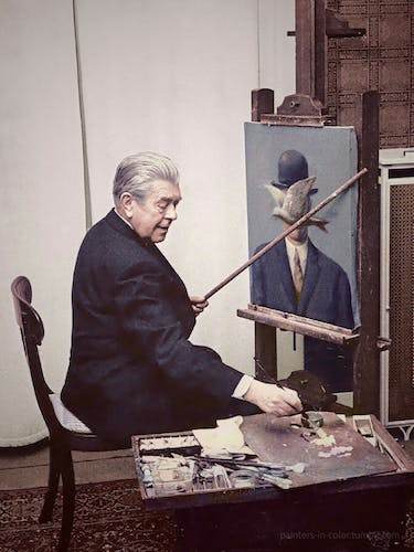 Magritte at work in his studio.