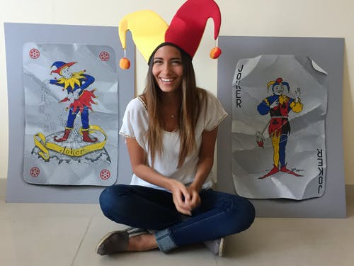 Artist Nourine Hammad with two of her playing card artworks.