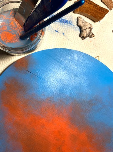 Vera Vizzi works on one of her round backgrounds in her studio.